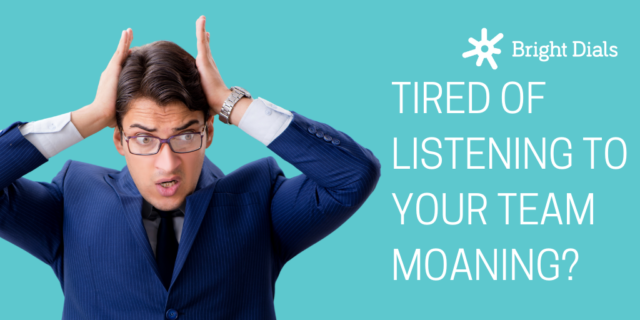 Man in suit tired of listening to his team moaning